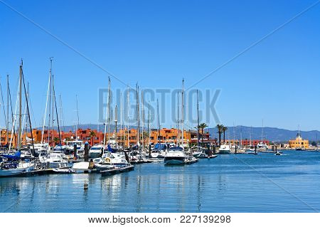 Portimao, Portugal - June 7, 2017 - Luxury Yachts And Motorboats Moored In The Marina With Apartment