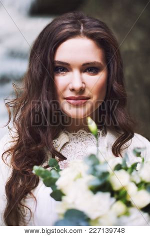 Beautiful Russian Girl With A Bridal Bouquet Of Flowers