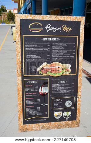 Albufeira, Portugal - June 8, 2017 - Burger Restaurant Menu Along The Promenade In The Marina Area,