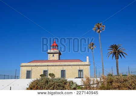 View Of The Lighthouse With Its Red Painted Top, Ponta Da Piedade, Algarve, Portugal, Europe.
