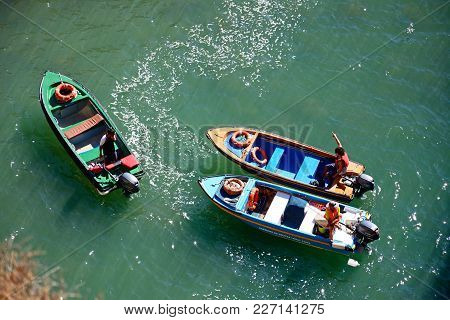 Ponta Da Piedade - June 8 2017 - Elevated View Of Tour Boats In The Sea With Owners Readying For Pas