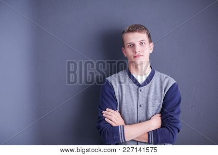 Portrait Of A Young Man On Black Background.portrait Of A Young Man.