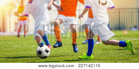 Children Having Fun Playing Soccer Game. Youth Soccer Match For Kids. Outdoor Football Tournament On