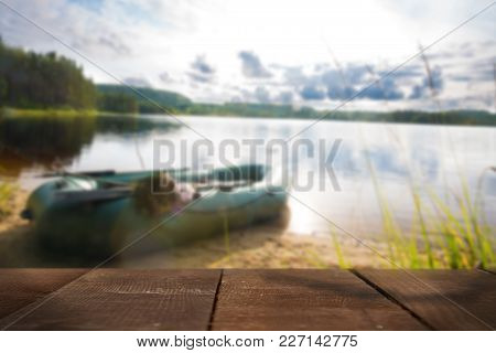 Boat On The Lake With Wooden Board