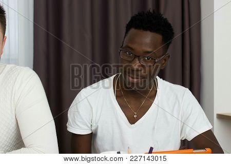African Student Portrait, Portrait Of African Student, African Student Sits On Table Closeup