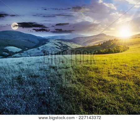 Time Change Concept Over The Grassy Meadow In Mountains. Beautiful Summer Countryside Under The Gorg