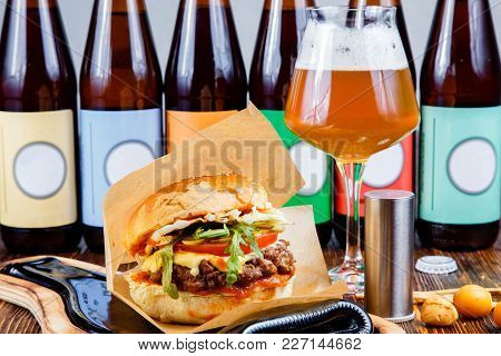 Tasty Hamburger And A Glass Of Beer