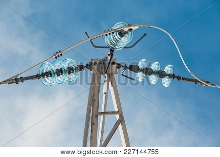Glass Prefabricated High Voltage Insulators On Poles High-voltage Power Lines, Close Up