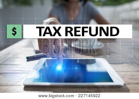 Tax Refund Text On Virtual Screen. Business And Finance Concept