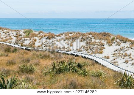 Natural Sand Beach With Wooden Walkway And Coastline, Natural Landscape Background