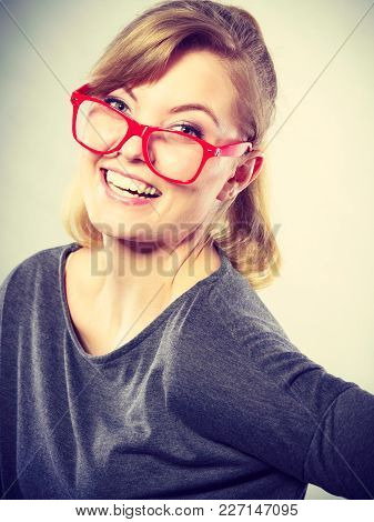 Fun Leisure Casual Past Time Relax Concept. Nerdy Girl Fooling Around. Silly Blonde Woman In Glasses