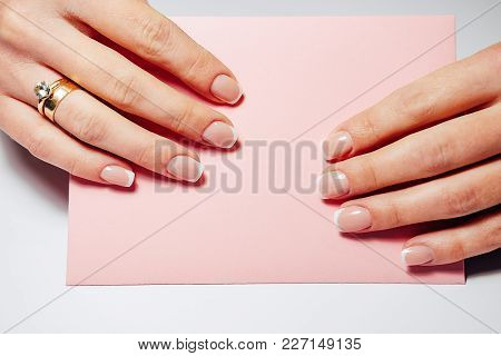 French Nail Extensions. Women With Beautiful Manicure And Wedding Ring Holding A Pink Envelope With