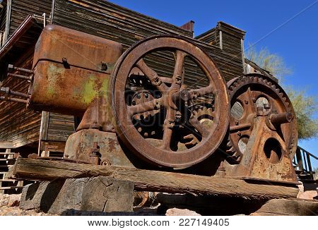 The Flywheel And Gears Of An Old Gas Engine Used In A Mining Operation.