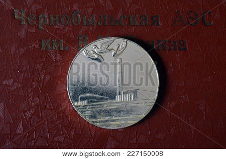 Commemorative medal. Disaster on Chernobyl power plant. 1986 Incription of background - Chernobyl nuclear power plant named after Lenin (RUS)