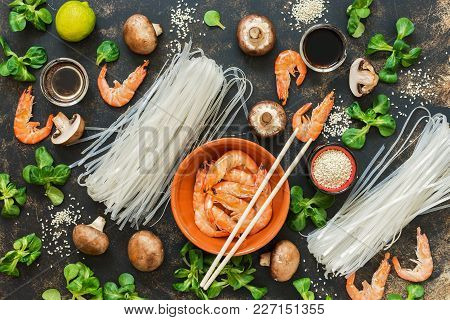 Asian Cuisine. Ingredients For Cooking On A Rustic Background. Rice Noodles, Shrimps, Mushrooms.vid