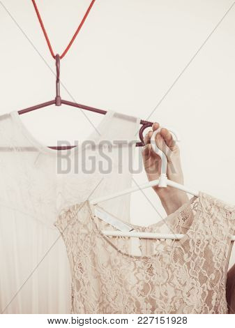 Woman In Shop Or Wardrobe Picking Clothes From Hangers, Making Perfect Elegant Summer Dress Outfit.