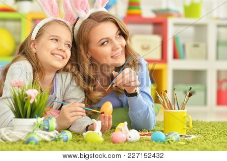 Mother And Daughter Colouring Eggs To Easter