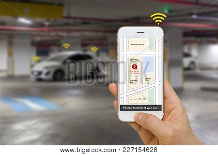 Concept Of Connected Car Being Located By Smartphone App Using Iot Of Internet Of Things Technology.