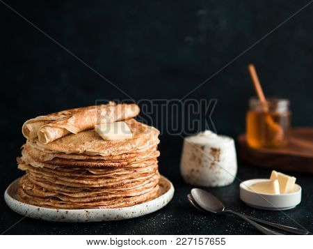 Stack Of Traditional Russian Pancakes Blini On Black Background With Copy Space. Homemade Russian Th