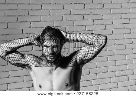 Young Handsome Man Bearded Guy With Beard Or Robber Bandit Gangster Wears Mask Of Black Fishnet Stoc