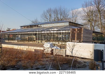 A Glasshouse Building Near A Garden From The Horticultural Show