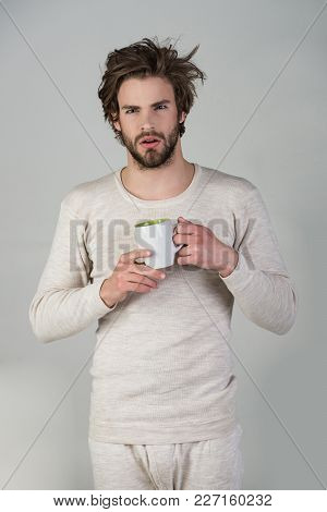 Morning With Coffee Or Milk. Man With Disheveled Hair Drink Mulled Wine. Sleepy Guy With Tea Cup On