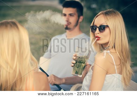 Love, Cheating, Date, Relationship. Woman Drink Mojito Cocktail With Man. Man Vaping Hookah Pipe Wit