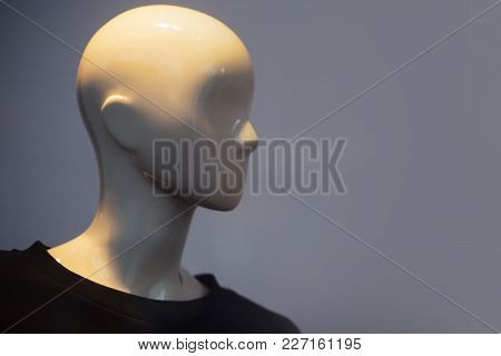 Dummy On Gray Background. Female Or Male Mannequin Wearing Black Sweater. Dummy Head For Boutique. F