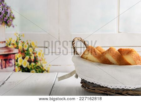 Toast Bread In Basket On White Wooden Table