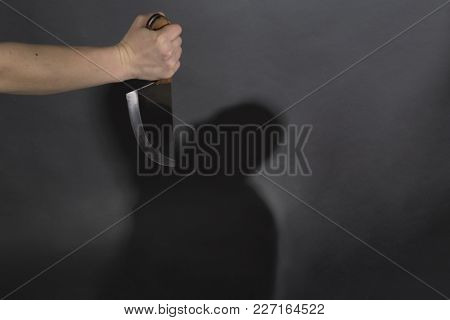 Hand With A Knife Weapon Threat Shadow