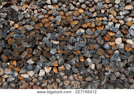 Pile Of Cut Wood As Background, Texture. Firewood