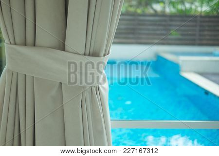 Curtain Drapery Interior Home Decoration On Window With Swimming Pool Background