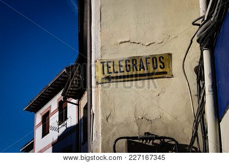 Old Telegraph Sign In Asturias, Spain. Only Mean Of Communication Of A Small Rural Village In Spain