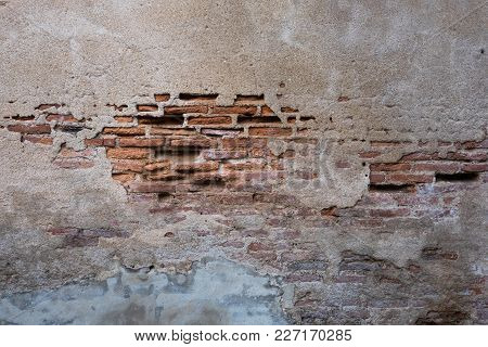 Cracked And Decayed Brick Stucco Wall Texture Background Weathered Long Time Ago.