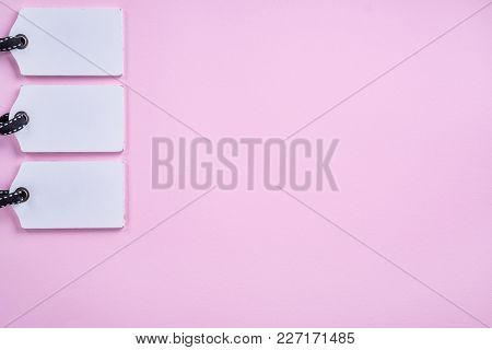 Empty White Tags In A Row On Pink Background. Top View. Mock Up Sample. Blank Price Tag. Design For