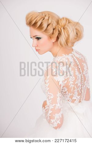 Nice, Pure And Innocent Young Lady In A Bridal Dress. Elegant Hairstyle And Make Up.