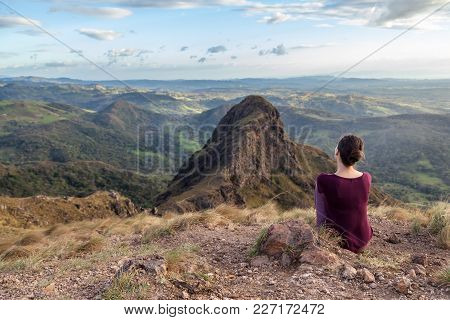 Young Woman Enjoying The Spectacular Views Of Guanacaste Costa Rica From The Top Of This Local Treas