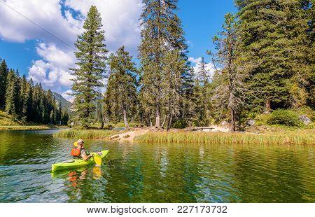 Lake Misurina Kayaking. Italian Dolomites. Auronzo Di Cadore. Caucasian Men In The Kayak.