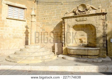 Victoria, Malta - 30 October 2017: Old Fountain In Center Of Victoria On Gozo Island, Malta