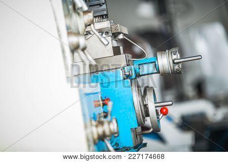 Metalworking Lathe Machine Adjustment Wheels. Industrial Machines Theme.
