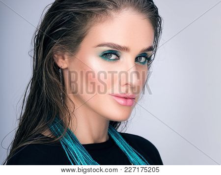 Beauty Closeup Portrait Of Beautiful Young Woman With Wet Hair And Professional Makeup. Necklace On