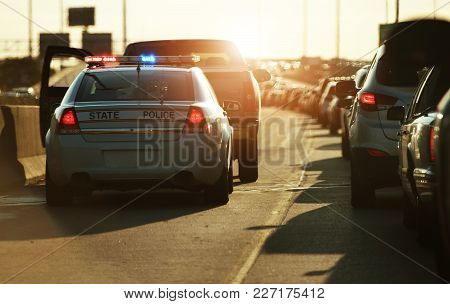 Police Traffic Stop. Policeman Stop Speeding Vehicle On The Side Of The Highway. Chicago, Illinois,