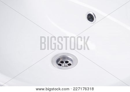 White Washbasin In The Bathroom Close-up View From Above