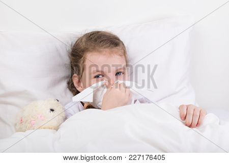 The Girl Lies On The Bed And Blows Her Snot In A Handkerchief From Her Nose