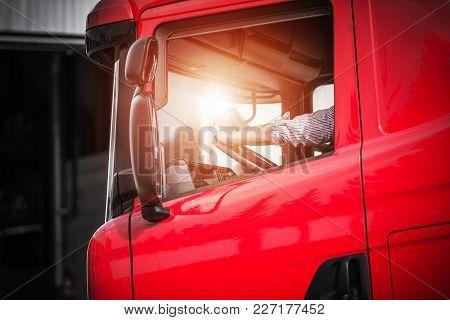Truck Driver Job. Caucasian Driver In His Euro Semi Truck.