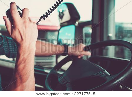 Truck Driving And Radio Chat With Other Drivers In Convoy.