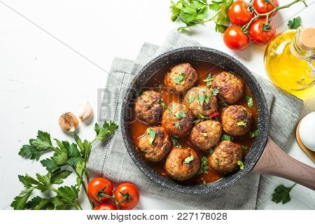 Meat Balls In Tomato Sauce In A Frying Pan. Top View With Copy Space On White Background.
