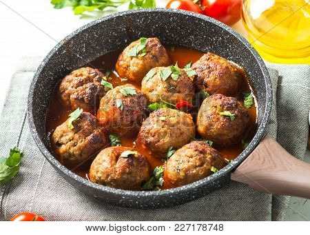 Meatballs In Tomato Sauce In A Frying Pan. Close Up.