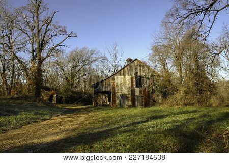 Color Photo Of Old Abandoned Barn In Warren County Missouri Just After Sunrise