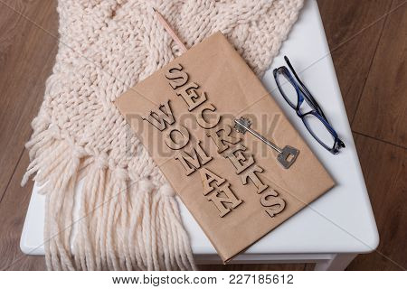 The Book Is Wrapped In Old Paper And Signed With Wooden Letters Woman Secrets, On The Book Key. Whit